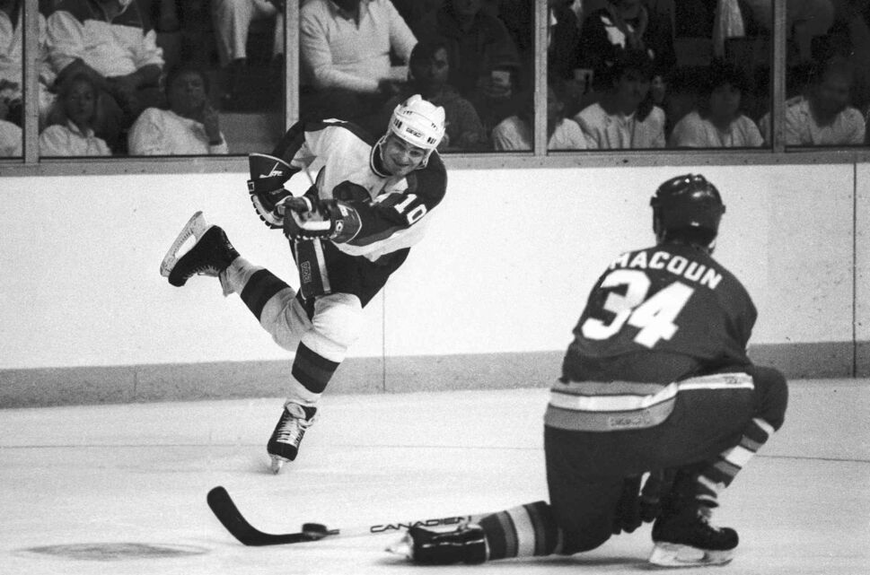 Hawerchuk takes shot past Calgary's Jamie Macoun on April 11, 1987. (Wayne Glowacki / Winnipeg Free Press files)