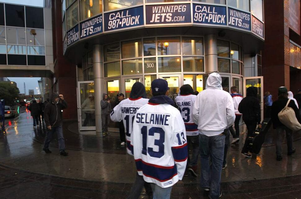Winnipeg Jets fans arrive at the MTS Centre Tuesday for the exhibition game between the Winnipeg Jets and the Columbus Blue Jackets. (WAYNE GLOWACKI/WINNIPEG FREE PRESS)
