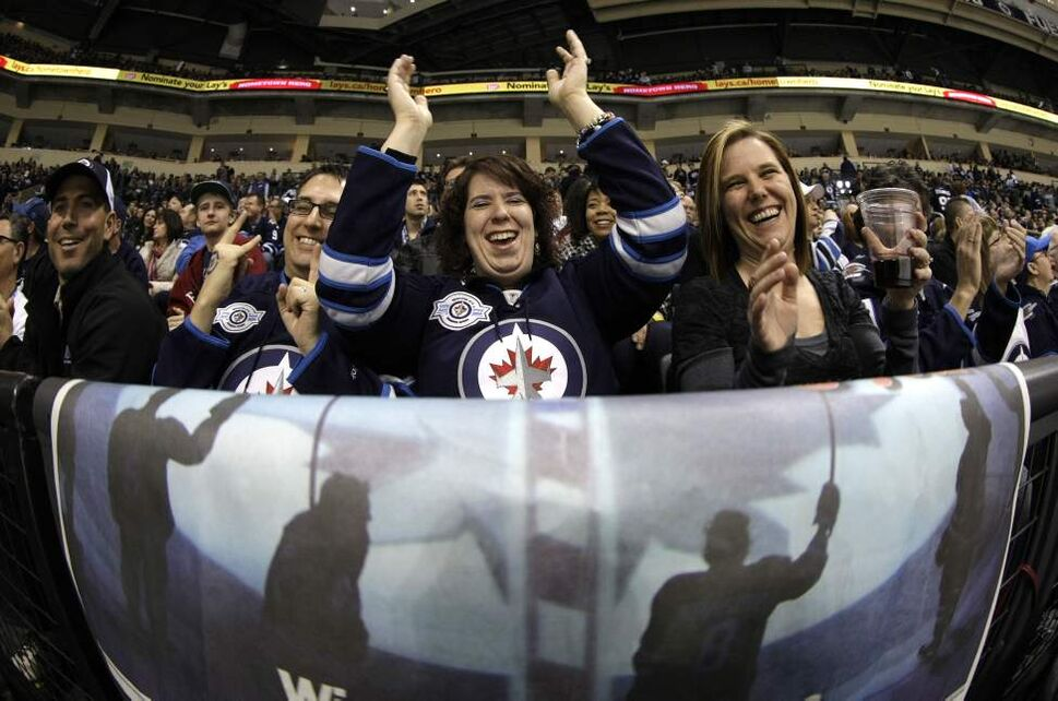 Winnipeg Jets fans cheer on their team during the second period of NHL action at MTS Centre in Winnipeg, Saturday, April 7, 2012. The Jets are hosting the Tampa Bay Lightning. (TREVOR HAGAN/WINNIPEG FREE PRESS)
