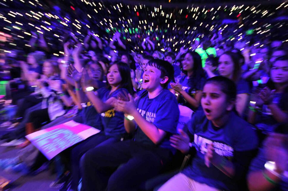 Students from H.C Avery School celebrate the on-stage events. (Ruth Bonneville / Winnipeg Free Press)