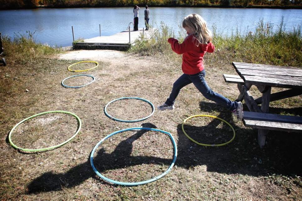 Anna Deal, 6, jumps over hula hoops while taking part in the Fall Family Festival at FortWhyte Alive.   Sunday, September 23, 2012.  (MIKE DEAL / WINNIPEG FREE PRESS)