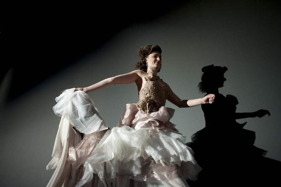 Royal Winnipeg Ballet dancer Amanda Green shows off a dress from the upcoming season's production of the fantasy themed The Princess and the Goblin at a fashion show and party fundraiser held at the Winnipeg Art Gallery. August 10, 2012. (COLE BREILAND / WINNIPEG FREE PRESS)