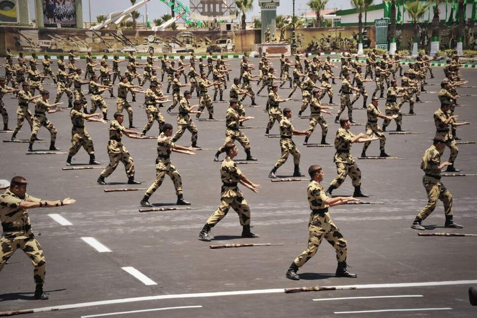 In this image released by the Egyptian President, Egyptian military soldiers perform during a medal ceremony, at a military base east of Cairo. (AP Photo/Mohammed Abd El Moaty, Egyptian Presidency)