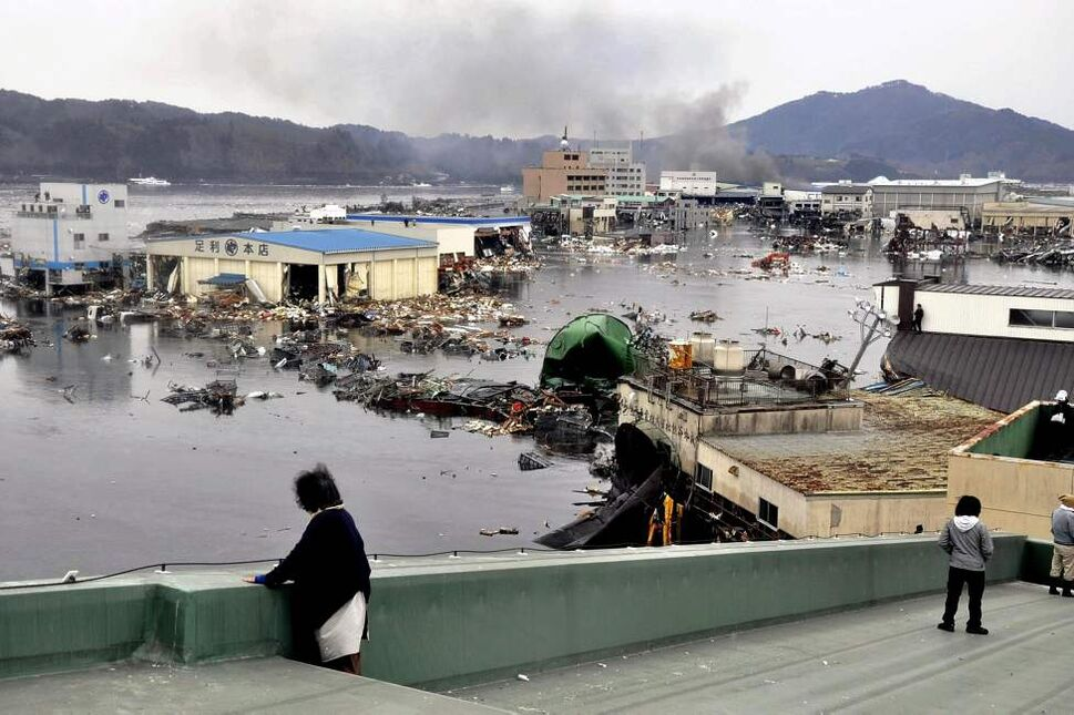 An earthquake-triggered tsunami washes away a warehouse and vehicles in Kesennuma, Miyagi prefecture (state), Japan,  Friday March 11, 2011. The ferocious tsunami spawned by one of the largest earthquakes ever recorded slammed Japan's eastern coasts. (AP Photo/The Yomiuri Shimbun, Keiichi Nakane)