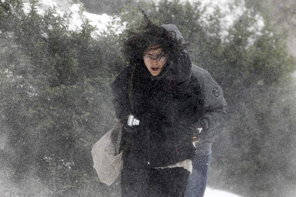 Eva Miranda, 27, battles through howling wind and snow as she makes her way across the campus at Appalachian State University on Tuesday, October 30, 2012. The North Carolina mountains got a taste of winter as the remnants of Hurricane Sandy combined with a cold front to bring high winds, freezing temperatures and several inches of snow to the area. (Chuck Liddy/Raleigh News & Observer/MCT)