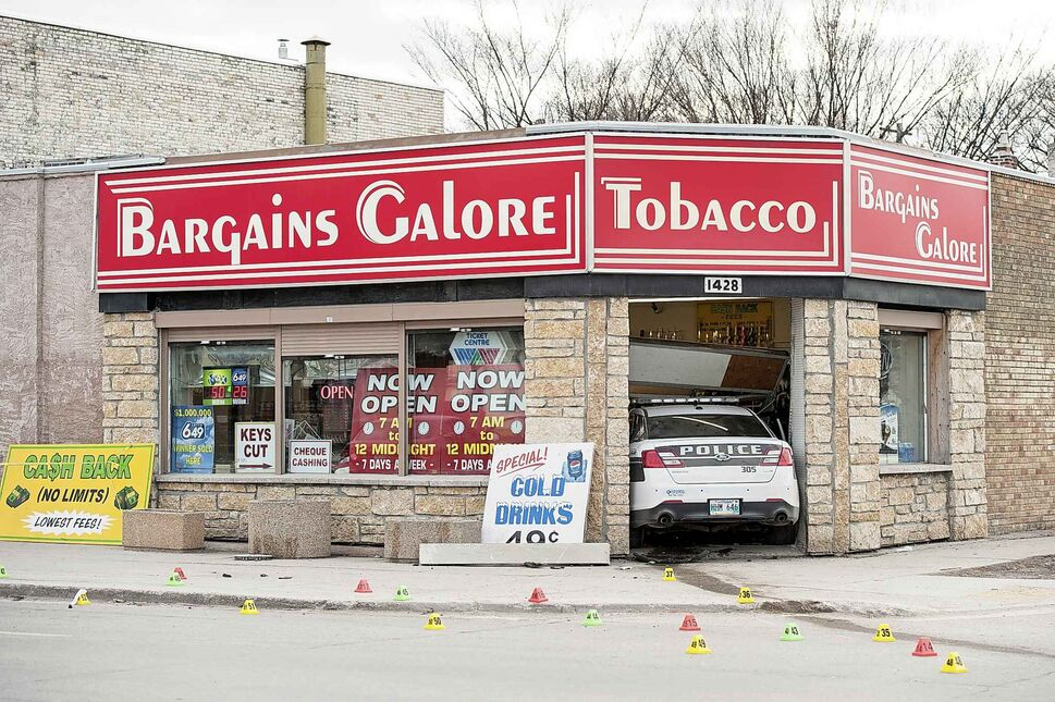 MIKE SUDOMA / WINNIPEG FREE PRESS</p><p>April 21 — The aftermath of a traffic collision Saturday evening resulting in three people (two police officers and the driver of the other car) taken to hospital and police cruiser crashing into a local convenience store, Bargains Galore, on the intersection of Polson Avenue and Main Street.</p>