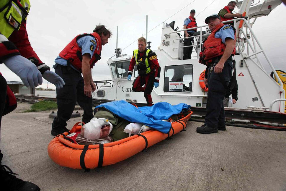 The victim is placed on a stretcher in preparation to be moved. (Ruth Bonneville / Winnipeg Free Press)
