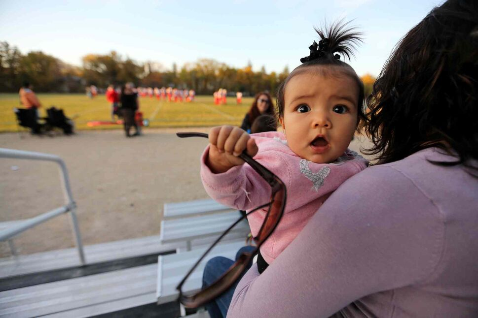 Six-month-old Serenity Neault supports her uncle who plays for the Vincent Massey Trojans as they take on the Kelvin Clippers. (TREVOR HAGAN / WINNIPEG FREE PRESS)