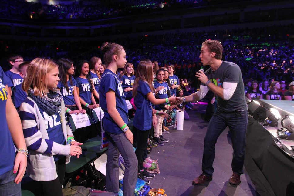 Craig Kielburger, co-founder of Free The Children, shakes the hands of students from H.C. Avery Middle School. (Ruth Bonneville / Winnipeg Free Press)