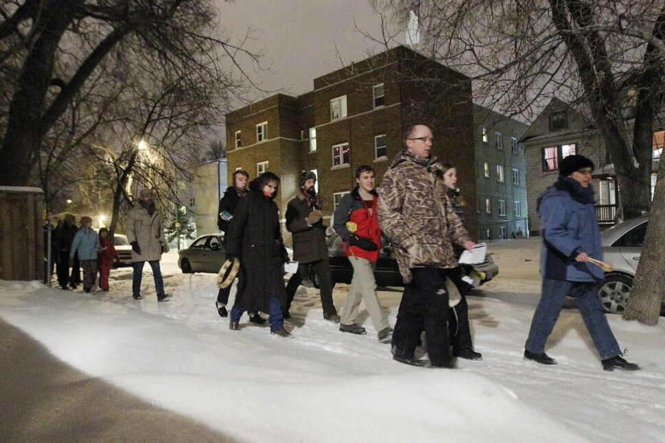 A Winnipeg neighbourhood turned cold for members of the West Broadway Community Ministry, whose symbolic Christmas Eve door-knocking in the tradition of La Posada highlighted a need for more affordable housing in the city. (John Woods / Winnipeg Free Press)