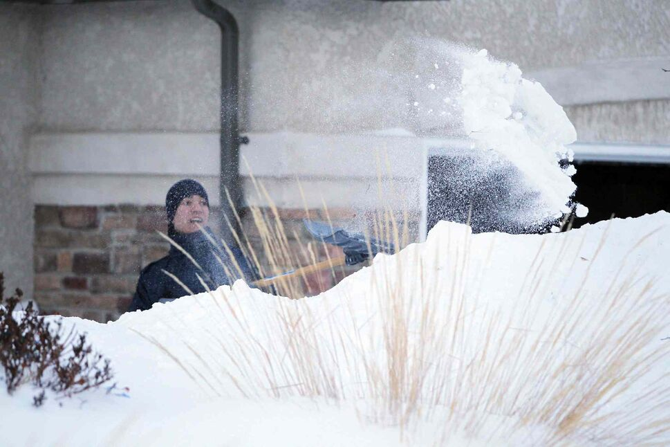 Darren Melanson shovels snow on Lyndale Drive in mid-February. Though Winnipeg is infamous for its harsh winters, this one has already been colder and snowier than many in recent memory. ( BORIS MINKEVICH/WINNIPEG FREE PRESS FILES)