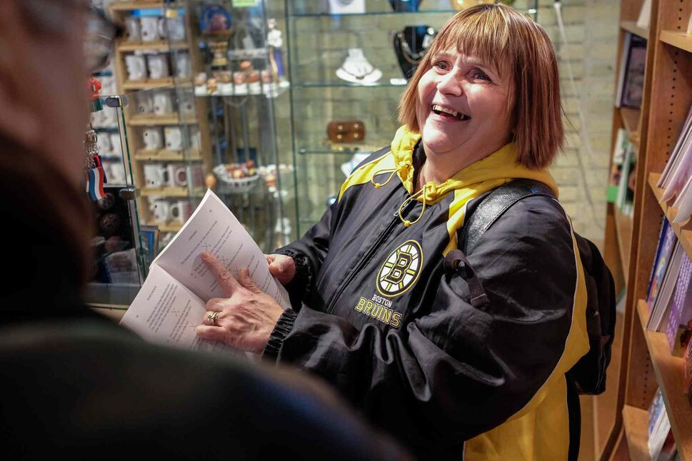 Cathy finds a hockey joke book while browsing the stores at The Forks.