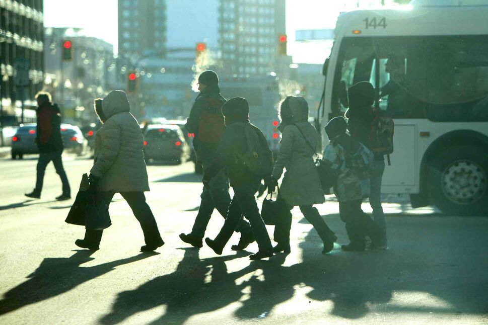 Winnipeggers hurry across Portage Avenue at Vaughan in high winds and bitterly cold temperatures Wednesday afternoon. This cold snap isn't expected to warm significantly until next week, according to Environment Canada. (Ruth Bonneville / Winnipeg Free Press)