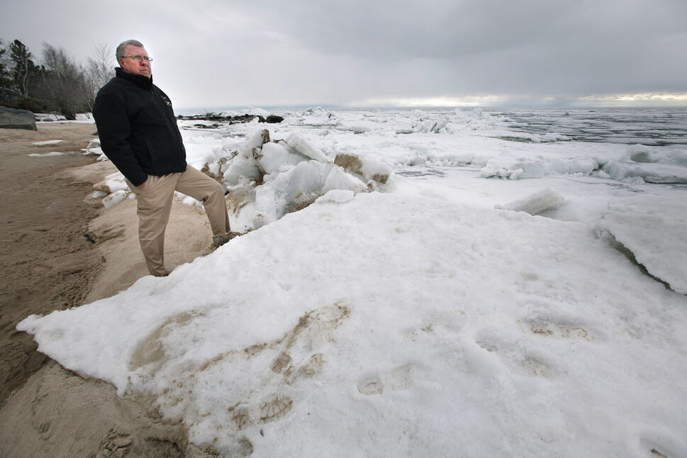 Rod Bollman, harbour master with the Victoria Beach Harbour Authority looks over the ice covered Lake Winnipeg.  (John Woods / Winnipeg Free Press)