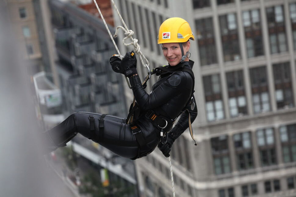 One of the participants in the Easter Seals Drop Zone is all smiles as she rappels down the RBC building Thursday.  (Ruth Bonneville / Winnipeg Free Press)