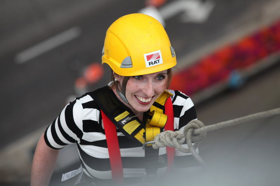 One of the participants in the Easter Seals Drop Zone dressed as a mime is all smiles as she rappels down the  RBC building Thursday.   (Ruth Bonneville / Winnipeg Free Press)