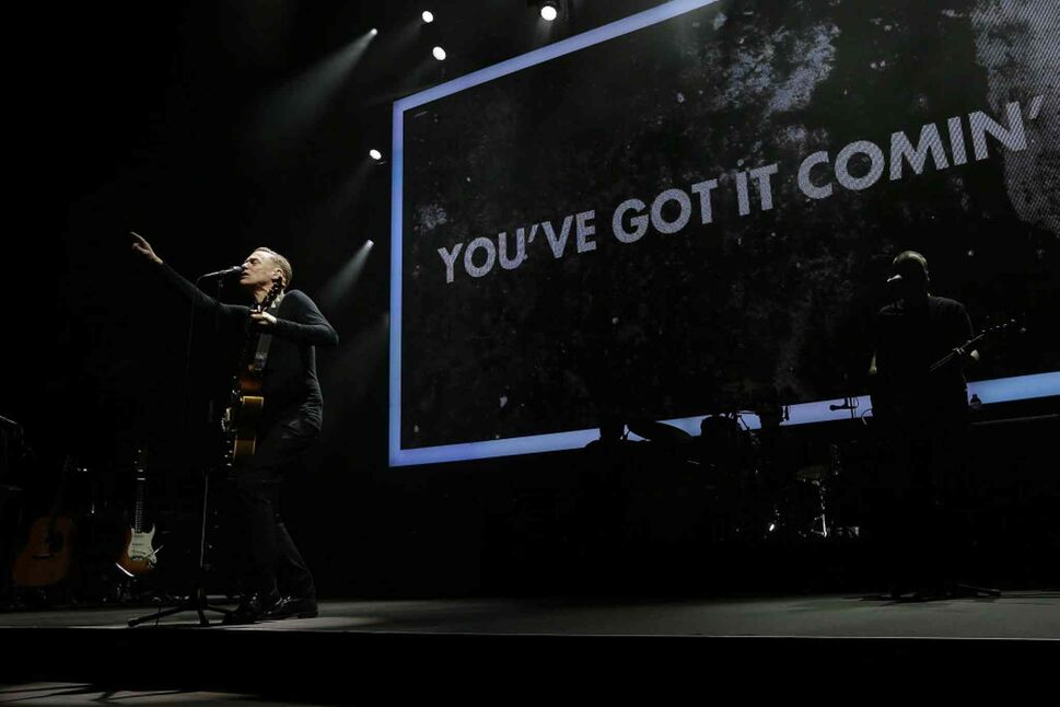 Adams gets the crowd going during the opening song of his set.  (John Woods / Winnipeg Free Press)