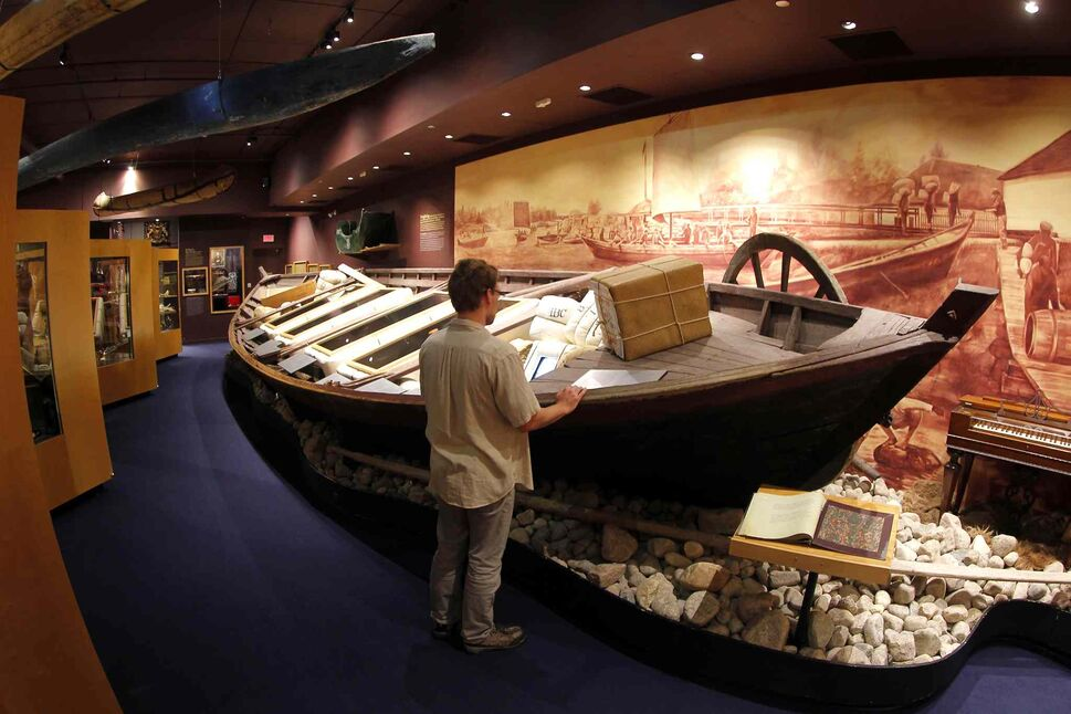 The Manitoba Museum. An old Hudson Bay boat on display. Staff member stands at the boat. BORIS MINKEVICH/WINNIPEG FREE PRESS