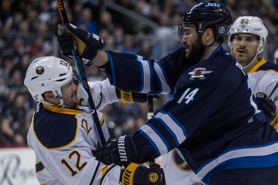 Winnipeg Jets' Anthony Peluso (14) and Buffalo Sabres' Brian Gionta (12) have words after the play during second period. (Mike Deal / Winnipeg Free Press)