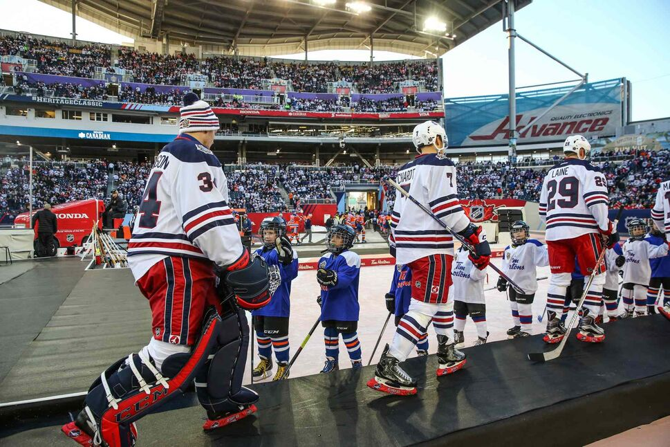 The Winnipeg Jets leave the ice for the second period intermission against the Edmonton Oilers at Investors Group Field.  (MIKE DEAL / WINNIPEG FREE PRESS)