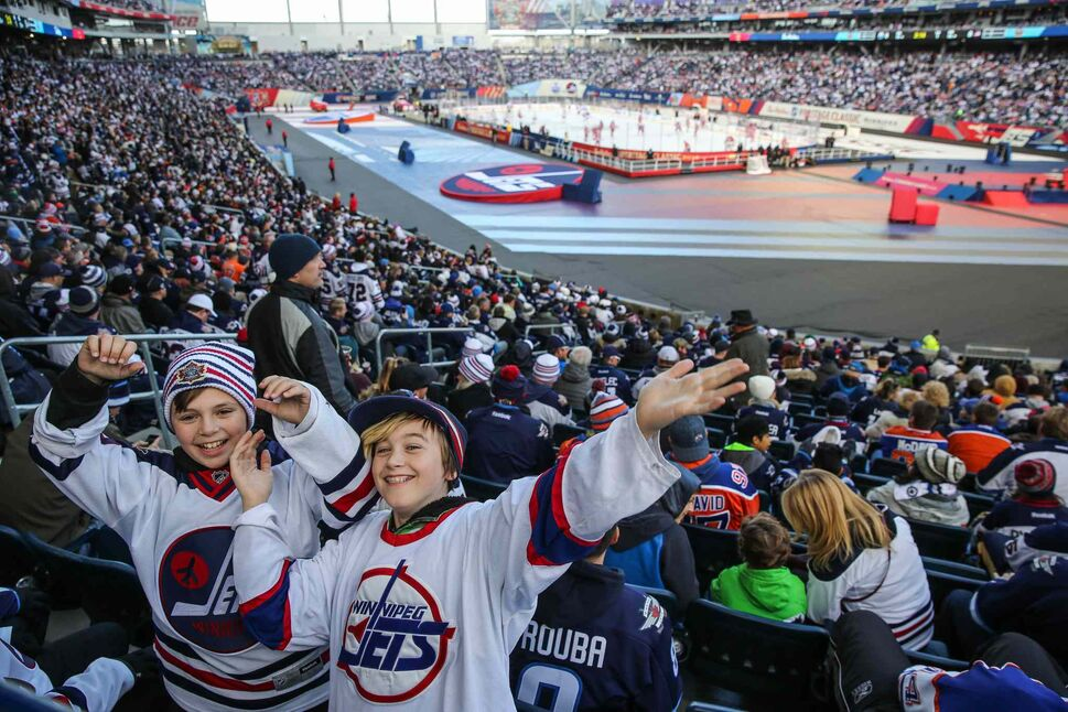 Kalen Barnett (left), 11, and Christian Thiessen (right), 11, cheer prior to the start of the NHL game between the Winnipeg Jets and the Edmonton Oilers at Investors Group Field on Sunday. 161023 - Sunday October 23, 2016 (MIKE DEAL / WINNIPEG FREE PRESS)