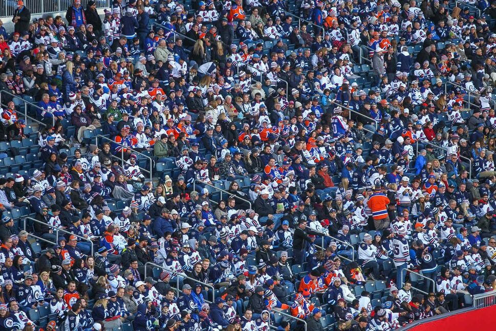 Fans get to their seats prior to start of the NHL Heritage Classic between the Winnipeg Jets and the Edmonton Oilers at Investors Group Field Sunday.  (MIKE DEAL / WINNIPEG FREE PRESS)
