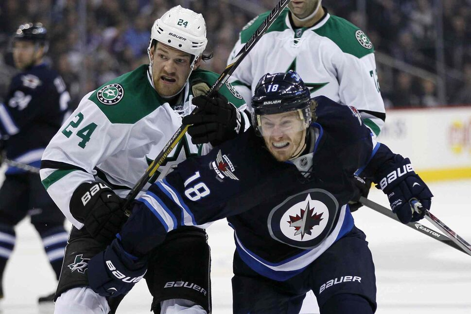 Winnipeg Jets' Bryan Little (18) attempts to get around Dallas Stars' Jordie Benn (24) during the second period. (JOHN WOODS / THE CANADIAN PRESS)