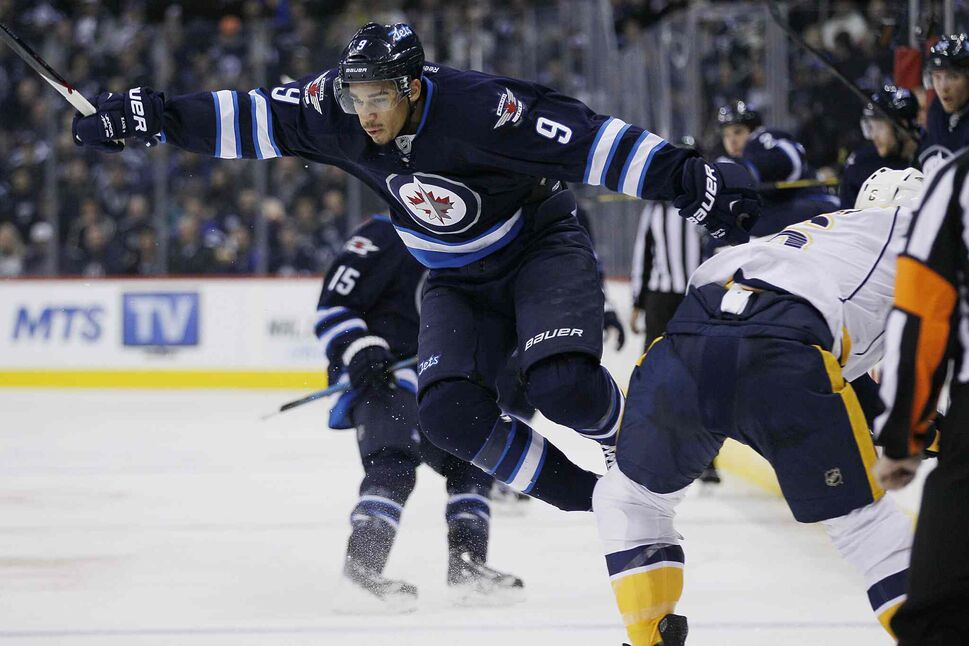 Winnipeg Jets' Evander Kane (9) attempts to avoid a check by Nashville Predators' Shea Weber (6) during the second period. (JOHN WOODS / WINNIPEG FREE PRESS)