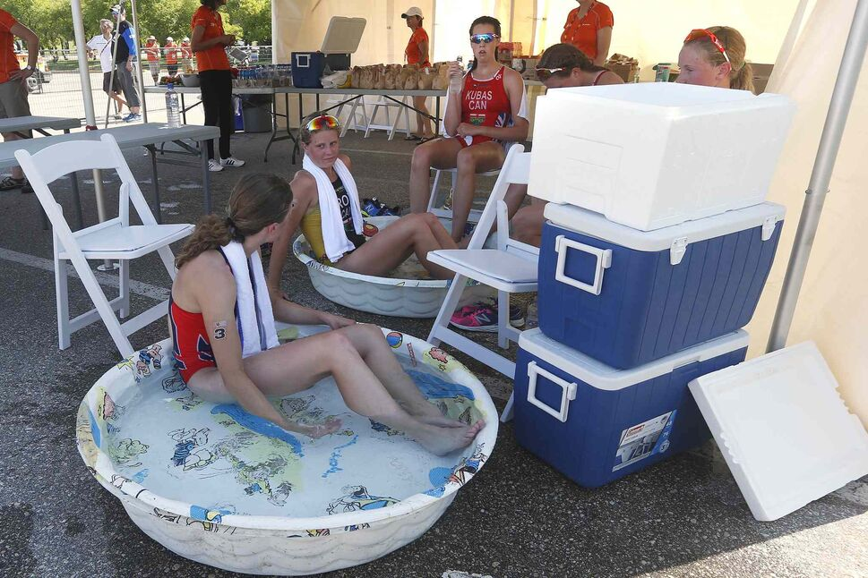 JOHN WOODS / WINNIPEG FREE PRESS</p><p>From left, British Columbia's Desirae Ridenour and Manitoba's Kyla Roy cool off in ice water after completing in the Canada Summer Games Female Individual Triathalon as Ontario's Ella Kubas, Ontario's Cassandra Dalbec and British Columbia's Hannah Henry look on at Birds Hill Park just outside Winnipeg, Manitoba on Monday, July 31, 2017.</p> (JOHN WOODS / WINNIPEG FREE PRESS)