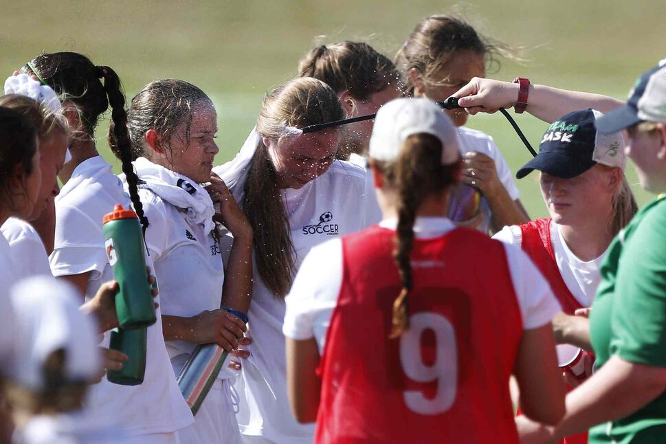 JOHN WOODS / WINNIPEG FREE PRESS</p><p>Saskatchewan players are sprayed with ice water during a first half water break during their soccer match against Quebec at the Ralph Cantafio Soccer Complex, Monday, July 31, 2017.</p> (JOHN WOODS / WINNIPEG FREE PRESS)