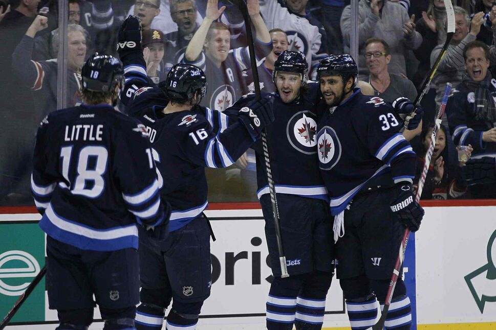 Winnipeg Jets (from left) Bryan Little, Andrew Ladd, Keaton Ellerby and Dustin Byfuglien celebrate Ellerby's goal against the Chicago Blackhawks during the second period. (JOHN WOODS / THE CANADIAN PRESS)