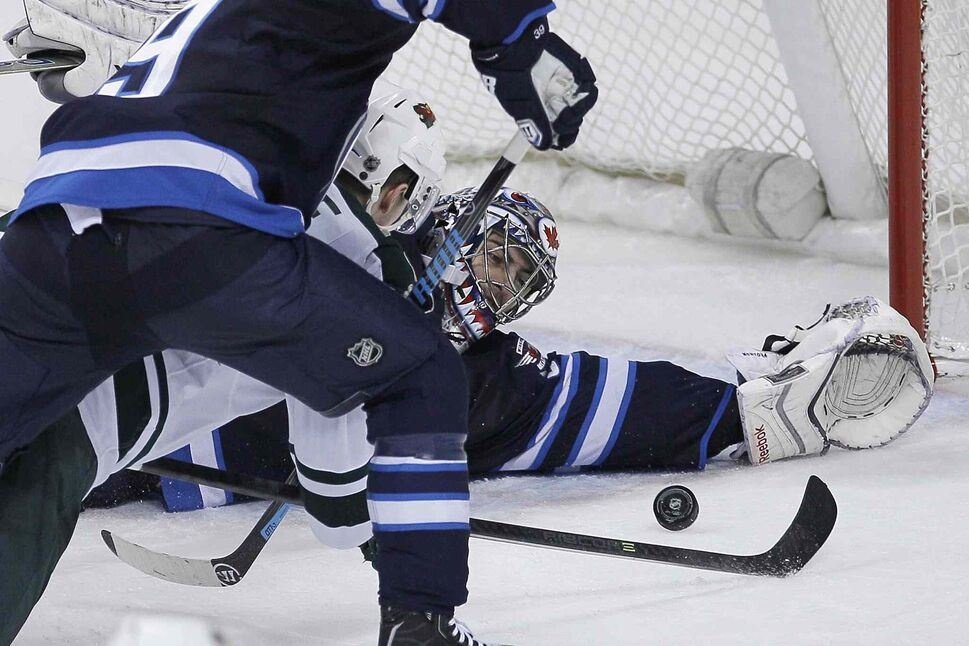 Winnipeg Jets goaltender Al Montoya (35) saves a shot from Minnesota Wild's Charlie Coyle during the third period. (JOHN WOODS / THE CANADIAN PRESS)