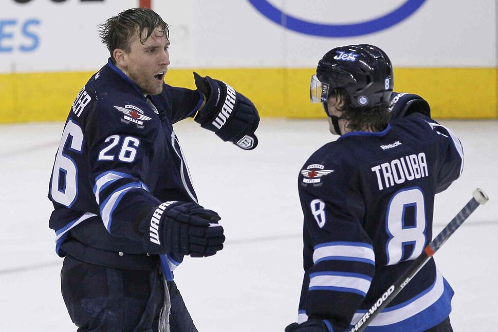 Winnipeg Jets forward Blake Wheeler (left) and defenceman Jacob Trouba celebrate Wheeler's goal against the Minnesota Wild during the third period. (JOHN WOODS / THE CANADIAN PRESS)