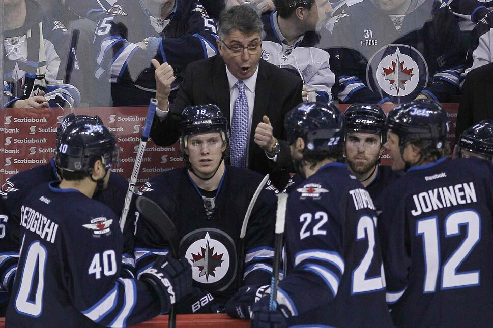 Winnipeg Jets head coach Claude Noel talks to his players during a third-period timeout. (JOHN WOODS / THE CANADIAN PRESS)