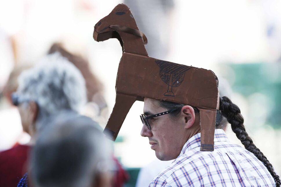 MP Robert-Falcon Ouellette wears a hat with an equine theme.