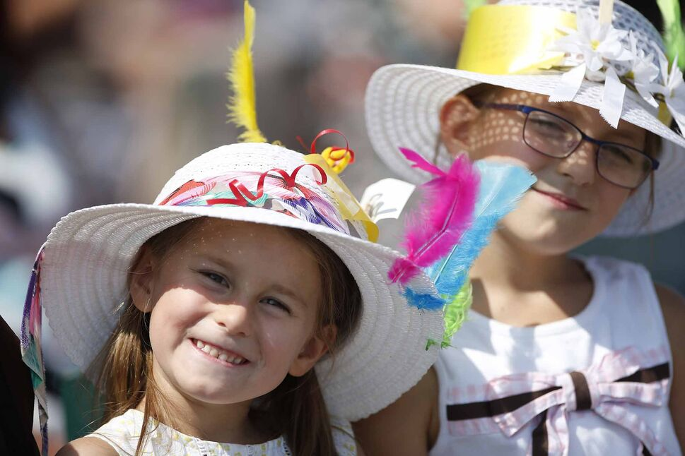 Annika, 5, and Nora Hansen, 7, wearing fancy hats.