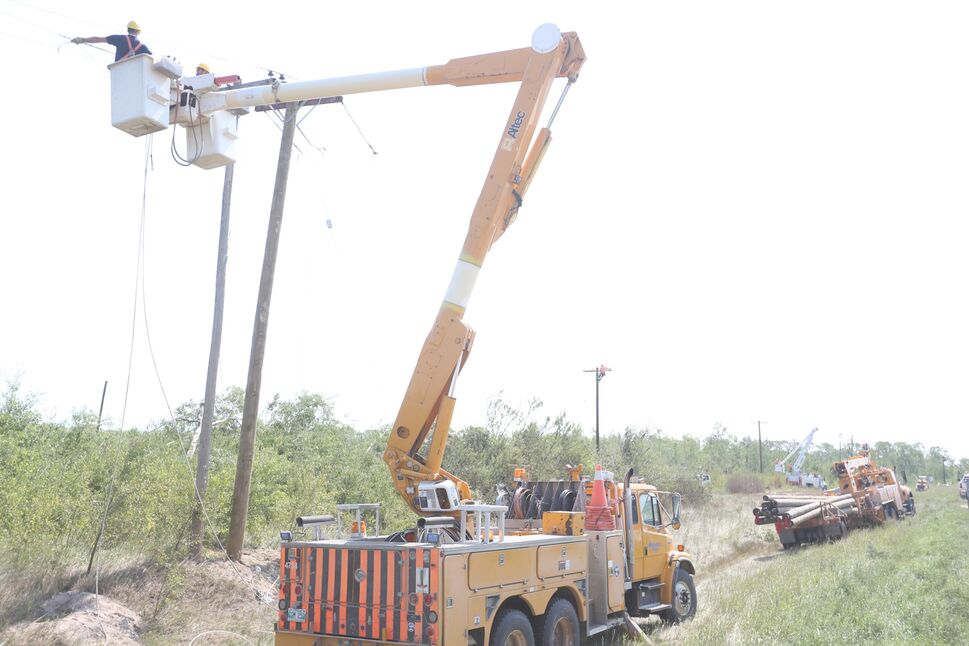 Manitoba Hydro crews worked to replace six poles just outside of Alonsa on Saturday after the tornado hit.  (Melissa Verge/The Brandon Sun)