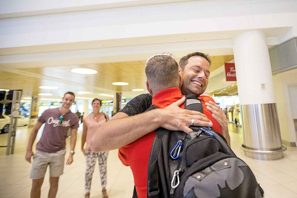 Marco Kiunka hugs his stem cell recipient, Jamie Benzelock.