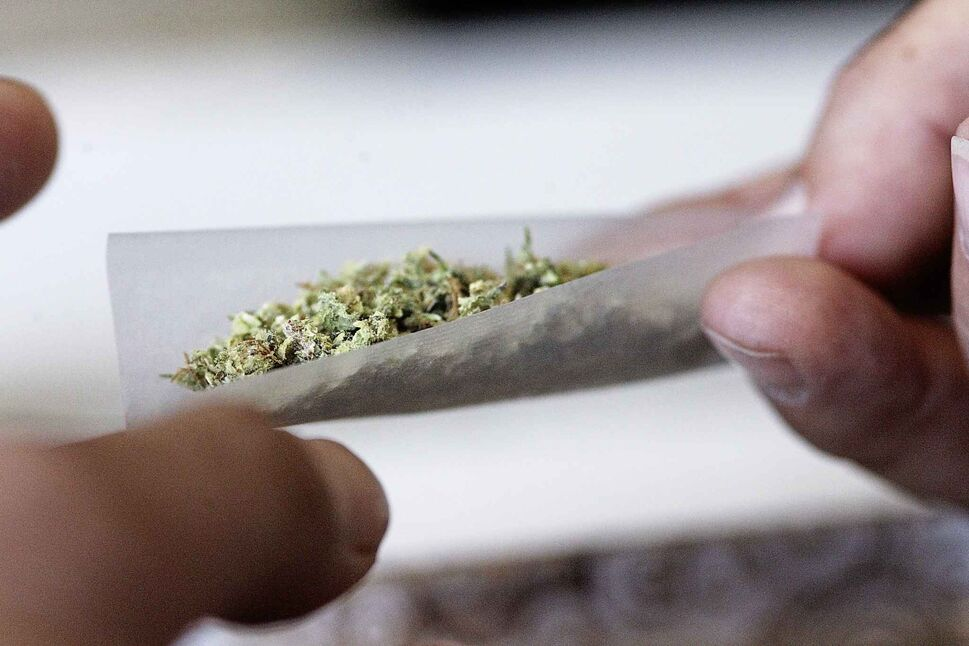 Statistically speaking, the Canadian rolling this joint is likely to be young and male. (Matt Goerzen / The Brandon Sun files)