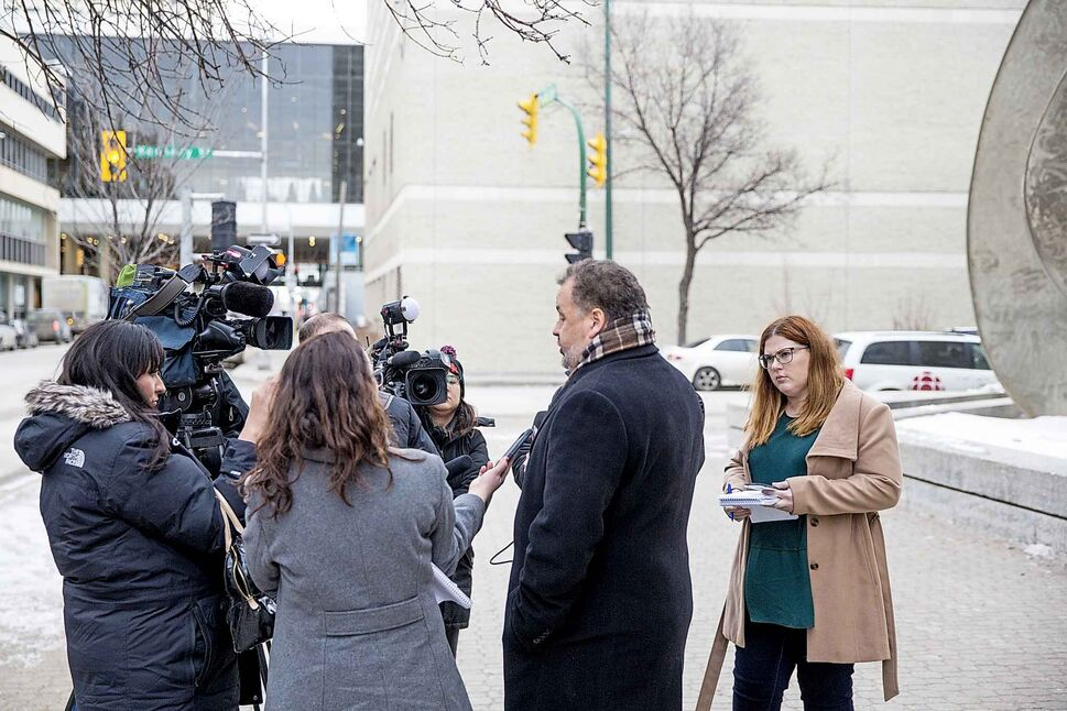 Courts reporter Katie May (right) in a scrum outside of the Law Courts. MIKAELA MACKENZIE / WINNIPEG FREE PRESS