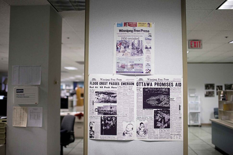 Papers from days gone by hang on the wall in the newsroom. MIKAELA MACKENZIE / WINNIPEG FREE PRESS