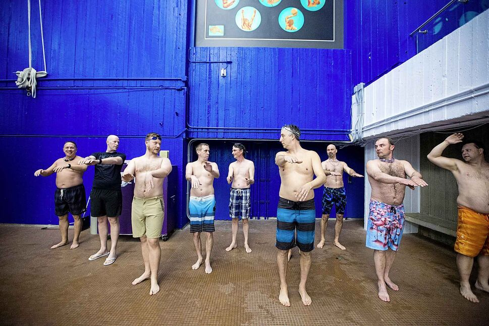 MIKAELA MACKENZIE / WINNIPEG FREE PRESS Manitoba's first men's synchronized/artistic swimming team practises on the deck at the Pan Am Pool on April 6. Eleven fathers/husbands formed the team in February to support their daughters/wives in the Aquatica Synchro Club.