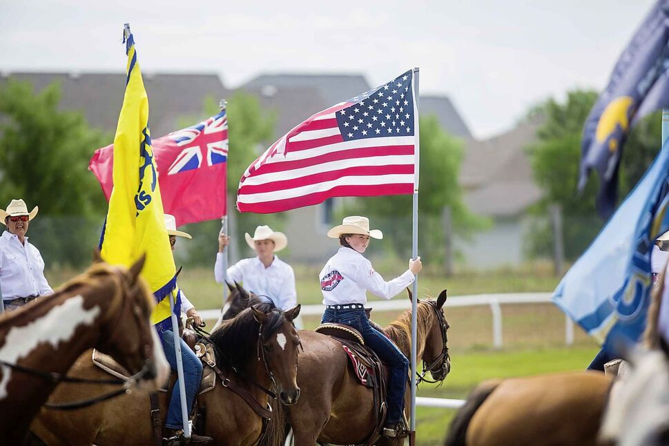 Flag-bearers at the Manitoba Stampede in Morris.