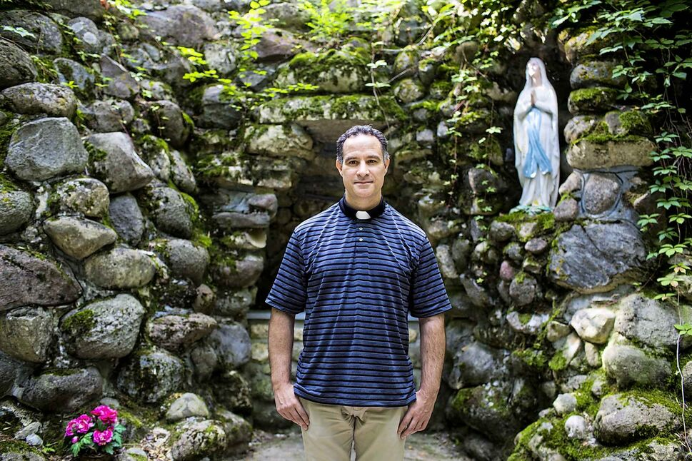 MIKAELA MACKENZIE / WINNIPEG FREE PRESS<p/> Reverend Dominic La Fleur at Our Lady of Lourdes Grotto and Shrine near St. Malo Provincial Park, a site that's becoming more popular with city churchgoers.