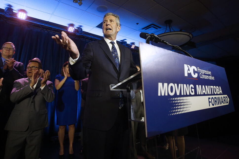 Manitoba PC leader and premier Brian Pallister celebrates winning the Manitoba election.  (JOHN WOODS / THE CANADIAN PRESS)