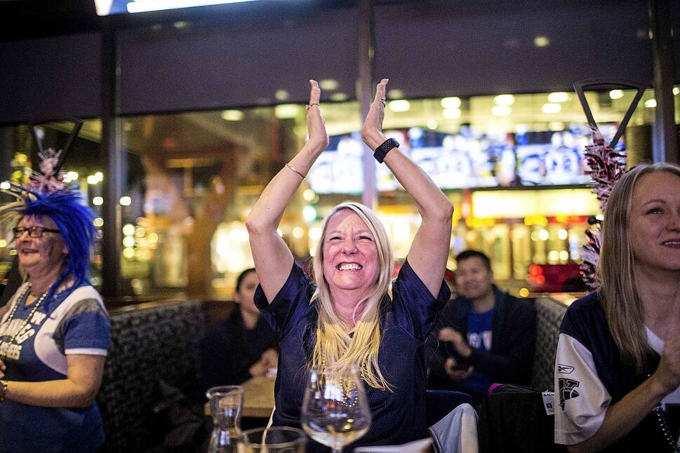 Bombers fan Donna Collins celebrates the Bombers' near-certain win near the end of the game at Boston Pizza in Winnipeg on Sunday, Nov. 24, 2019. (Mikaela MacKenzie / Winnipeg Free Press)