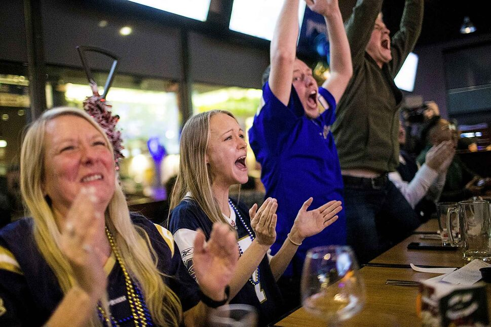 Bombers fan Kelsey Collins-Kramble celebrates the Grey Cup win. (Mikaela MacKenzie / Winnipeg Free Press)