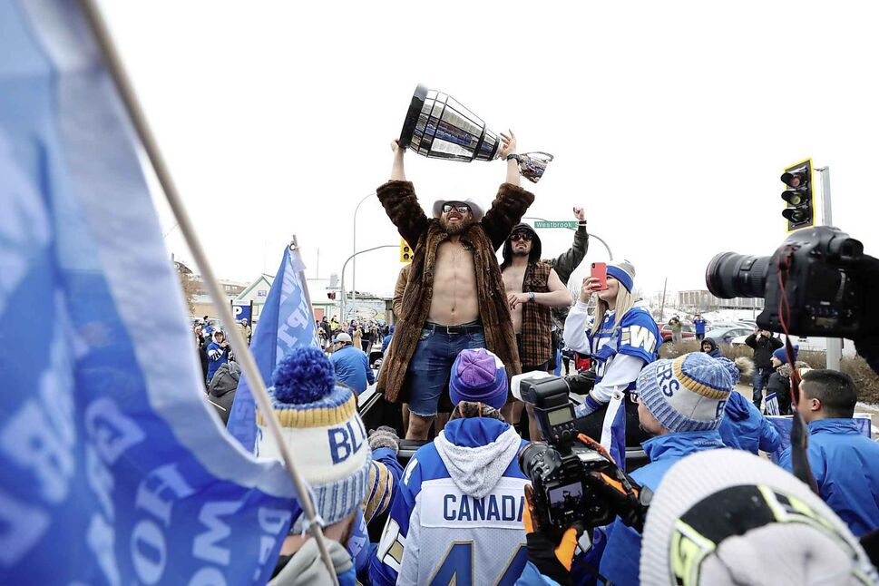 The cup is hoised in the air.  (Ruth Bonneville / Winnipeg Free Press)