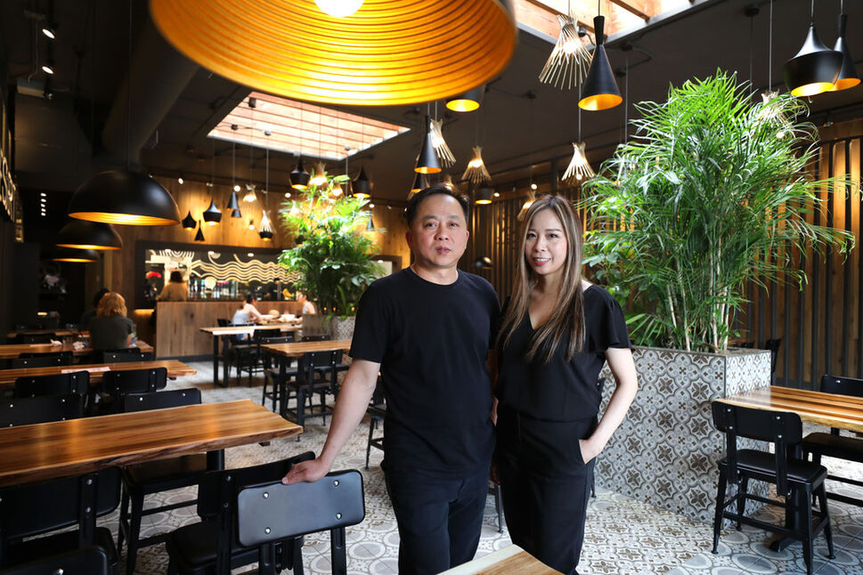 Tom and Heather Hoang in their newly opened Osborne Street location of Pho Hoang. (Ruth Bonneville / Winnipeg Free Press)