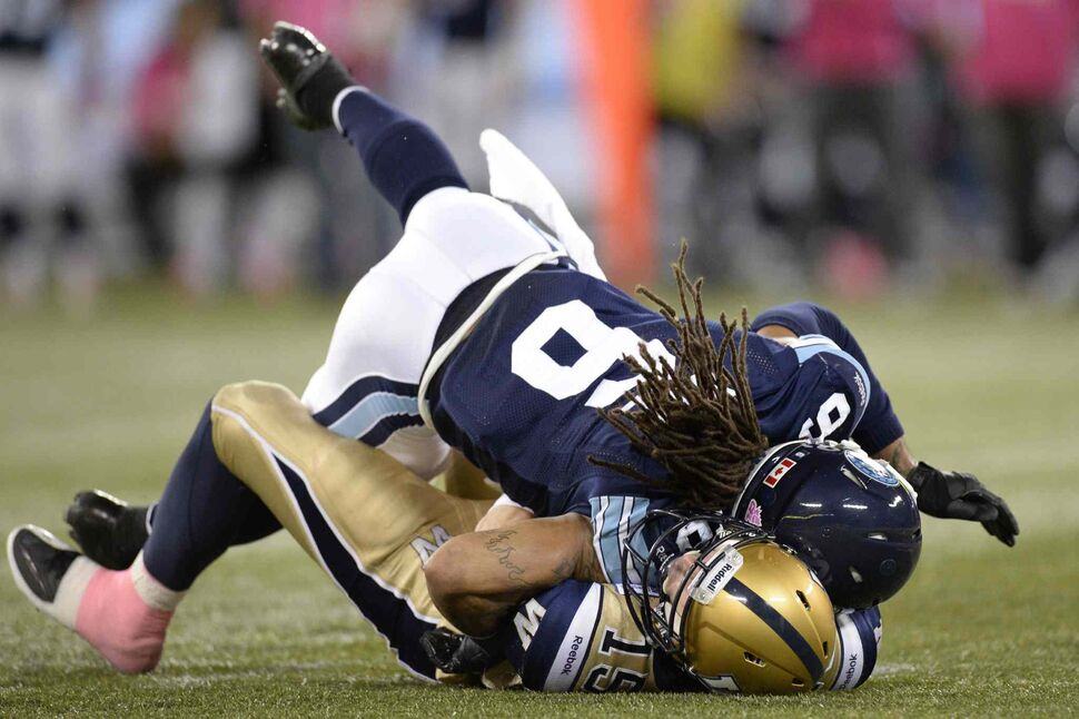 Winnipeg Blue Bombers' Max Hall is sacked by Toronto Argonauts' Marcus Ball during the second quarter. (Frank Gunn / The Canadian Press)